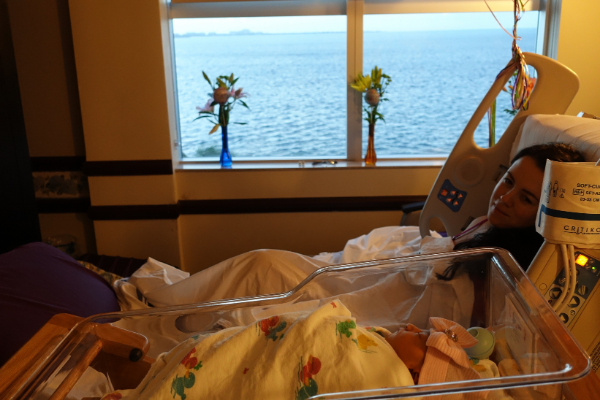 Image: Mother with baby in hospital after delivery (Hospital Bag: Getting Ready for Baby Jessica Alvarez-Ducos Contributor Miami Mom Collective)
