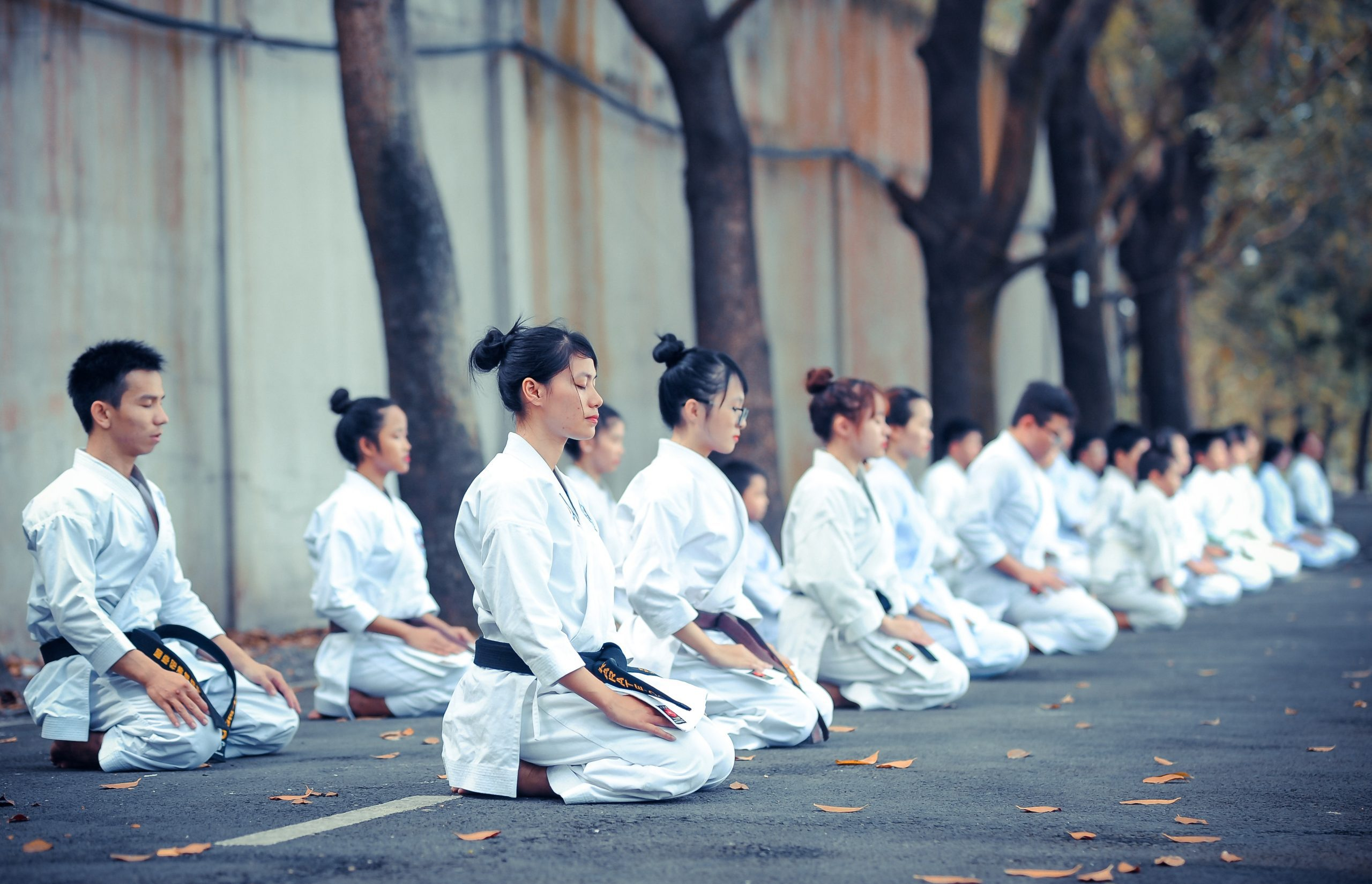 A group of people meditating (National Women's Health Week & Why It's Important for Moms Zoe Costa Contributor Miami Mom Collective)