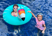 Vanessa's daughters playing in the pool (Sibling Rivalry: Tackle It With These 4 Strategies Vanessa Santamaria Contributor Miami Mom Collective)