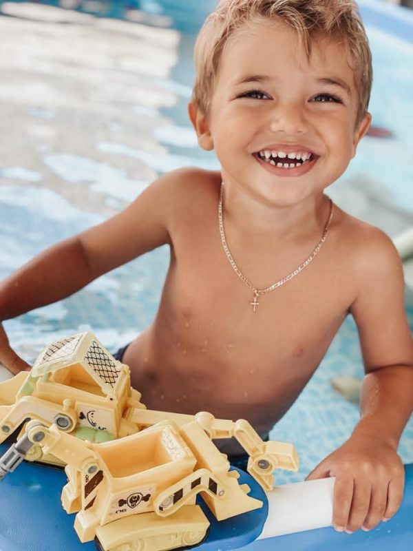 Dianna's son playing with some toys at the pool (Positive Affirmations for Toddlers and Preschool ChildrenDianna Hill Contributor Miami Mom Collective)