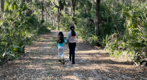 Two sisters hiking together (Sibling Rivalry: Tackle It With These 4 Strategies Vanessa Santamaria Contributor Miami Mom Collective)