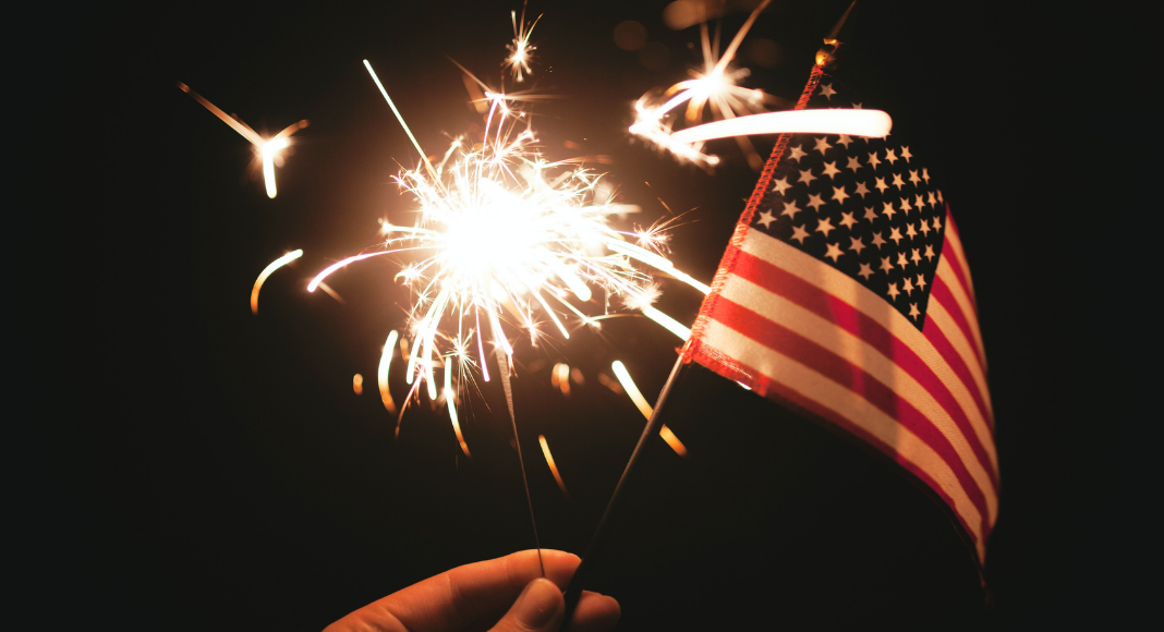A sparkler and an American Flag (Fireworks: What to Do and Where to See Them in Miami on the 4th of July Bella Behar Contributor Miami Mom Collective)