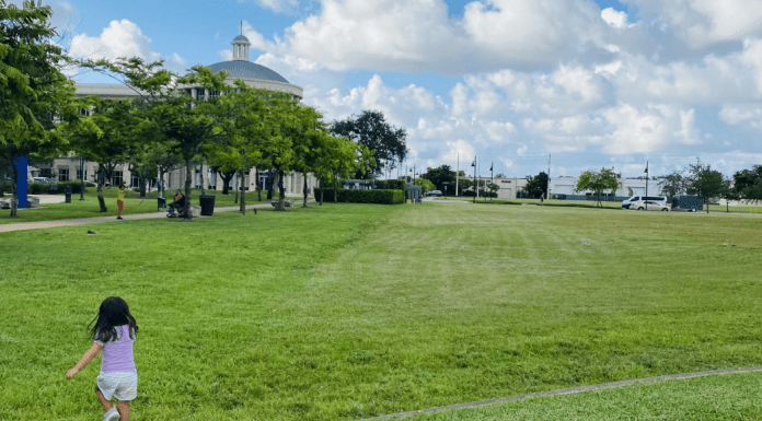 Valerie's daughter running in an open green space (Love Where You Live: Why I Love Living in Doral Valerie Barbosa Contributor Miami Mom Collective)