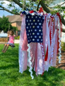 A smaller red, white, and blue American rag flag (Summer 2021 Parties Made Easy Aymee Blanco Contributor Miami Mom Collective)