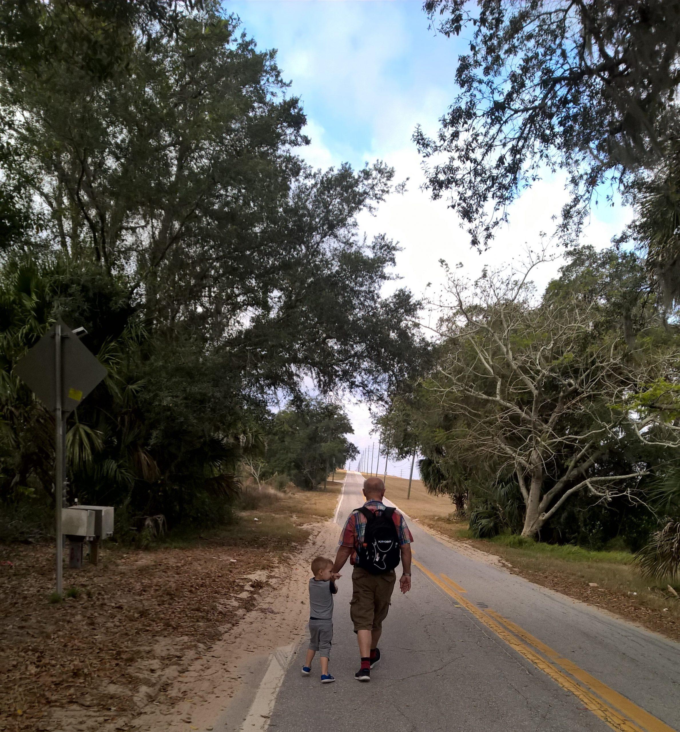 Rachell's son exploring the world with Grandpa (Rachel Hulsund Contributor Miami Mom Collective)