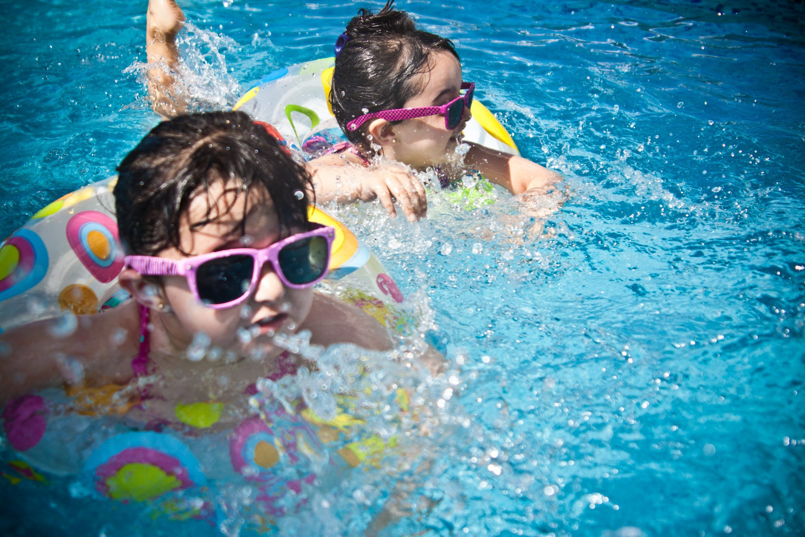 Sisters playing in the pool (Summer Fun that Leads to Lasting NEW Habits for the Entire Family Adita Lang Contributor Miami Mom Collective)