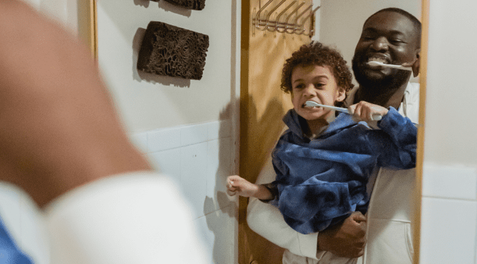 A father and son brushing their teeth (Favorite Things: Dr. Bob's Top 6 Dental Products for Kids Lynda Lantz Contributor Miami Mom Collective)