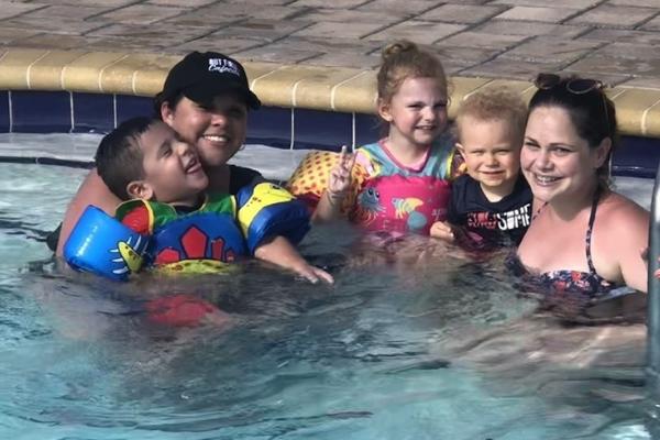 MMC Contributors Crystal Giraldo and Lorena Lougedo and their kids enjoying the pool (Lorena Lougedo Contributor Miami Mom Collective)