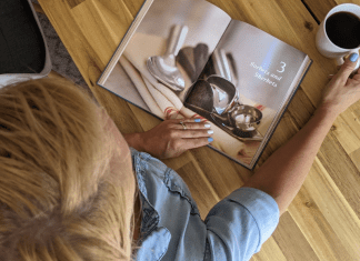 A woman looking at a book about ice cream (July is National Ice Cream Month: Give Me all the Sweetness! Rachel Hulsund Contributor Miami Mom Collective)
