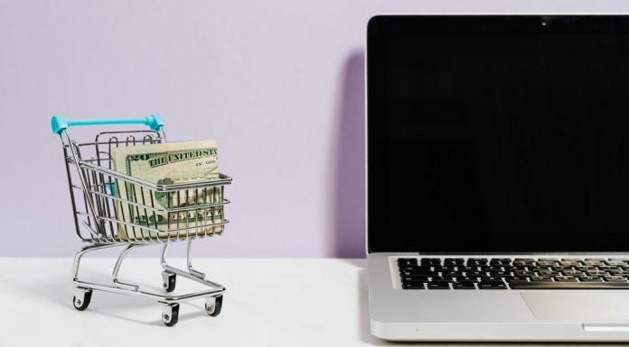 A laptop and a small grocery cart full of cash (Bargain Hunting: Money Saving Tips for Online Shopping Ana-Sofia DuLaney Contributor Miami Mom Collective)