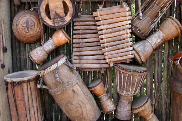 A display of hand carved drums, xylophones, and other instruments (Hispanic Heritage Month: Ways to Celebrate Lorena Lougedo Contributor Miami Mom Collective)