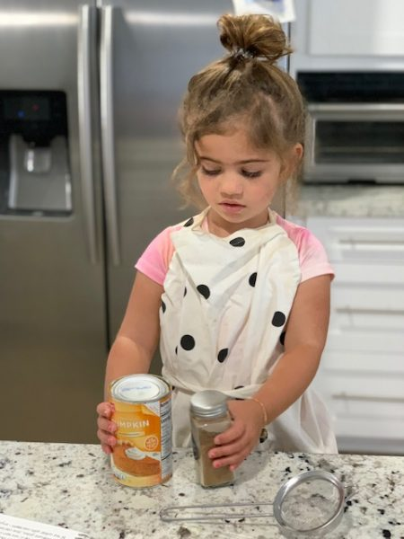 Alexa's daughter helping her in the kitchen (Pumpkin + Cold Brew: How To Make this Popular Fall Coffee at Home! Alexa Gonzalez Contributor Miami Mom Collective)