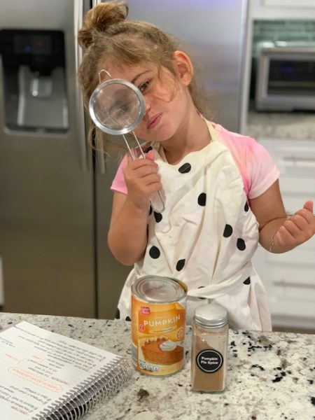 Alexa's daughter helping her make the pumpkin cream (Pumpkin + Cold Brew: How To Make this Popular Fall Coffee at Home! Alexa Gonzalez Contributor Miami Mom Collective)