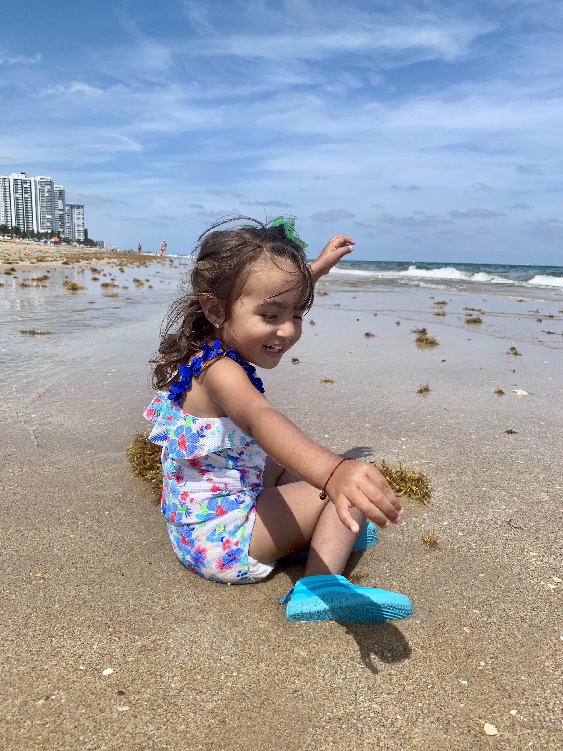 Julie's daughter exploring the beach (Beach More, Stress Less : Beach Day Tips and Hacks Jessica Alvarez-Ducos Contributor Miami Mom Collective)