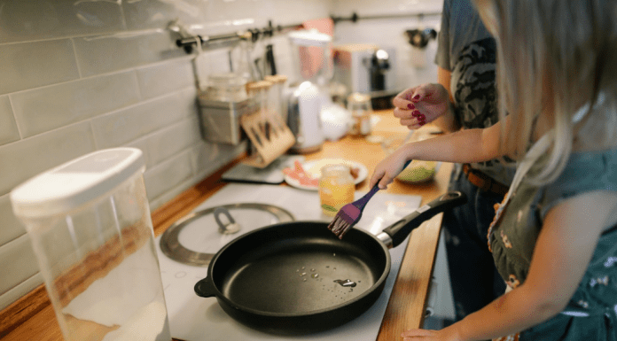 A mom and daughter cooking together in the kitchen (Summer Fun that Leads to Lasting NEW Habits for the Entire Family Adita Lang Contributor Miami Mom Collective)