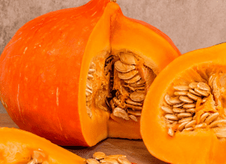 A sliced pumpkin with seeds (Fall's Most Fabulous Superfoods Your Plate Needs Monica Moreno Contributor Miami Mom Collective)