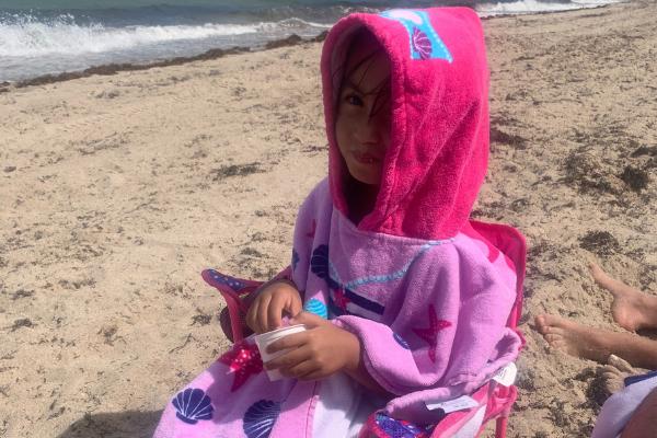 Jessica's daughter wearing a hooded towel (Jessica Alvarez-Ducos Contributor Miami Mom Collective)
