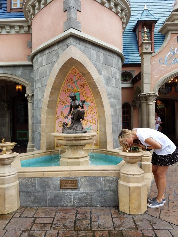 Sandra taking a drink at Cinderella's fountain (Sandra Jacquemin Contributor Miami Mom Collective)