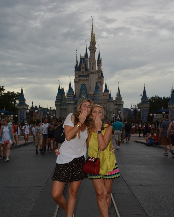 Sandra and her friend in front of Cinderella's castle (Disney Has Some Secrets, Sort Of Sandra Jacquemin Contributor Miami Mom Collective)