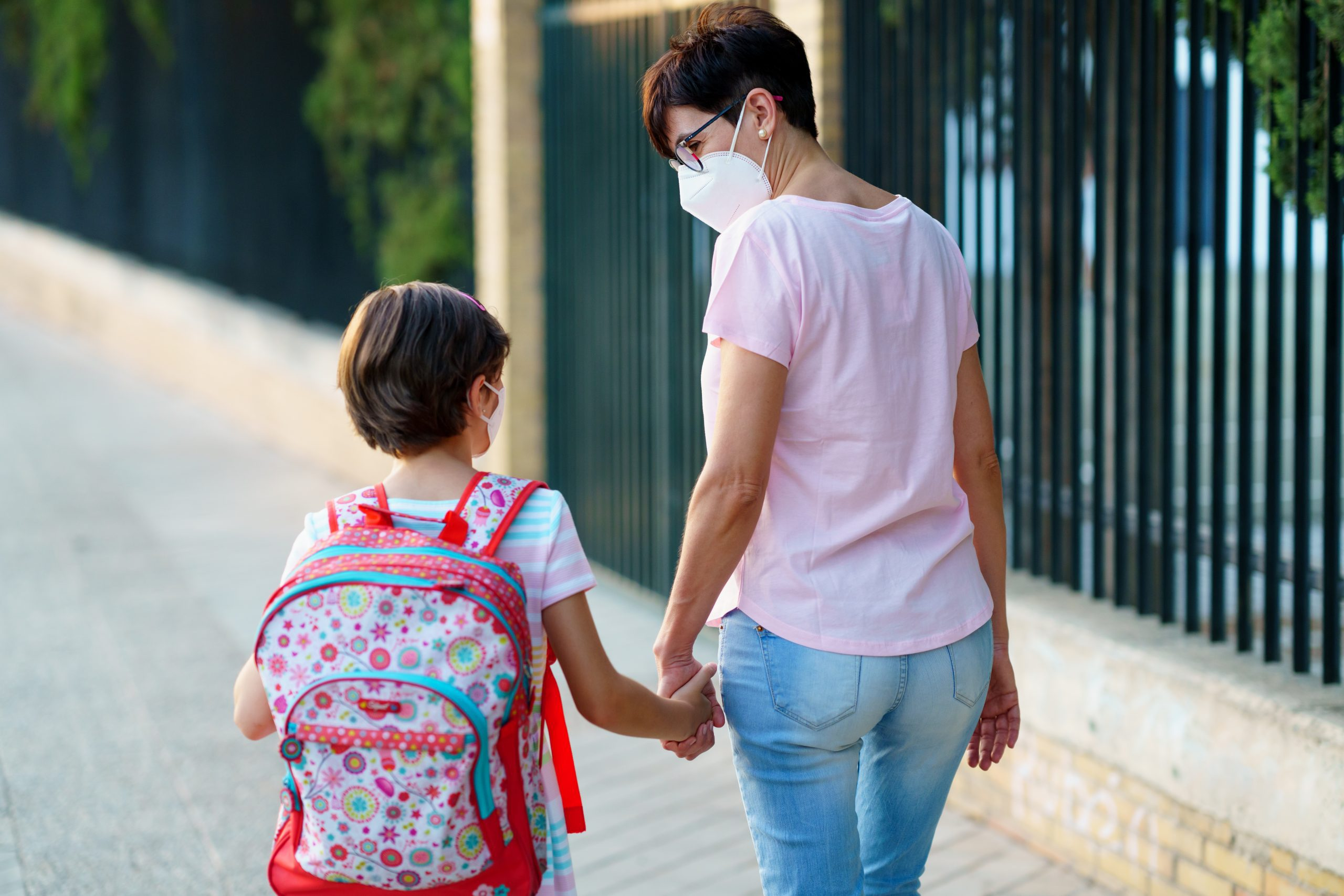 A mother and daughter walking to school (Kids and Tech: Back to School in a Pandemic Be Strong International Miami Mom Collective)