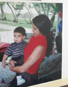Becky holding her son at his 1st birthday party (Remembering September 11th Becky Gonzalez Contributor Miami Mom Collective)