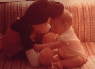 A picture of Sandra as an infant with her first Mickey toy (Disney Has Some Secrets, Sort Of Sandra Jacquemin Contributor Miami Mom Collective)