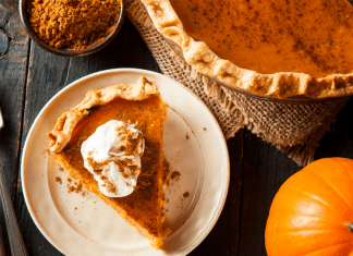 A slice of pumpkin pie on a festive table (7 Things to Add to Your Fall Bucket List This Year Vanessa Santamaria Contributor Miami Mom Collective)