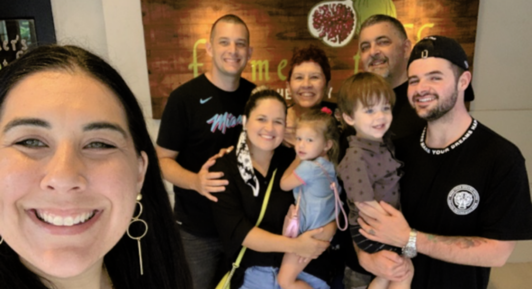 Holly with her husband, children, and grandchildren (Grandparents Day 2021: Becoming a Grandparent Is a Special Gift Holly Farver Contributor Miami Mom Collective)