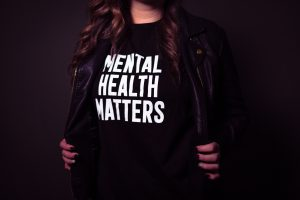 """Image: A woman wearing a shirt that says, """"Mental Health Matters"""" (Mental Illness Awareness Week: Breaking the Stigma Becky Gonzalez Contributor Miami Mom Collective)"""