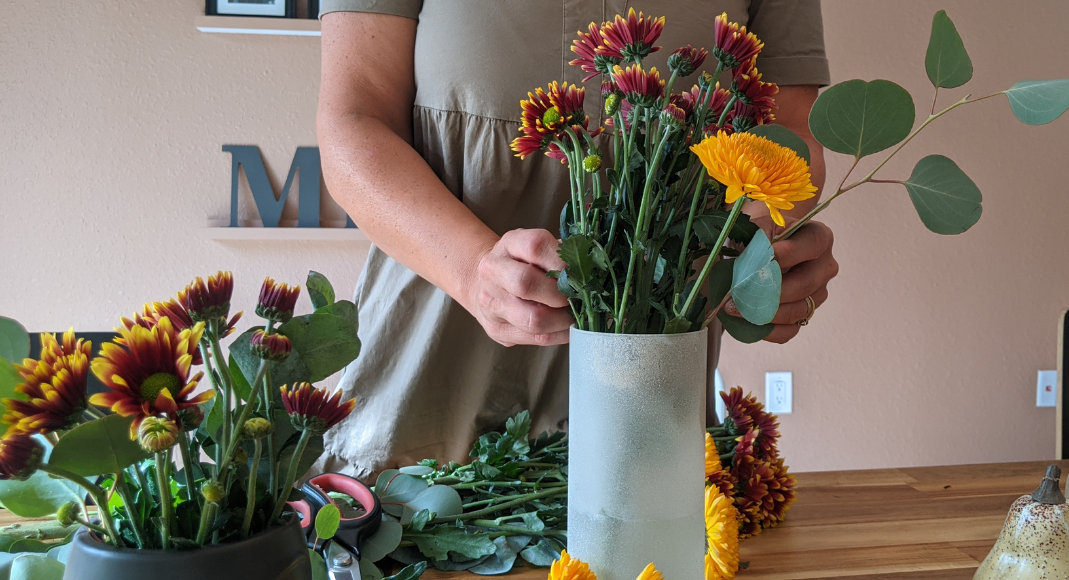 Image: Rachel arranging some mums in a vase (Get the Fall Feeling in Miami Rachel Hulsund Contributor Miami Mom Collective)