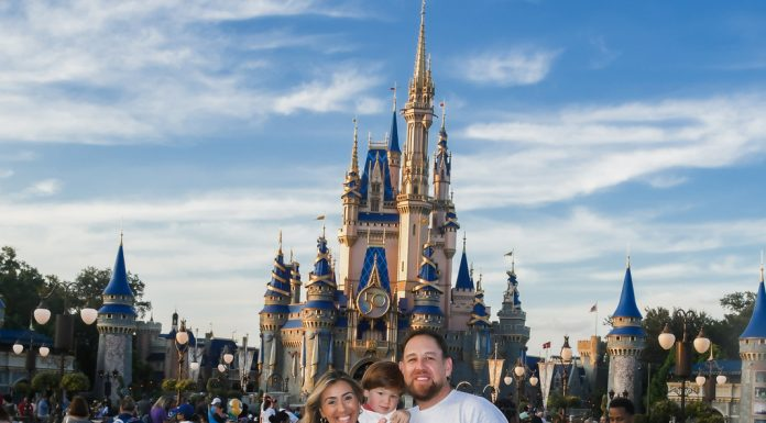 Image: Sandra with her husband and son in front of Cinderella's Castle at Disney (Disney at 50: Walt Disney World's Golden Birthday Celebration Sandra Jacquemin Contributor Miami Mom Collective)